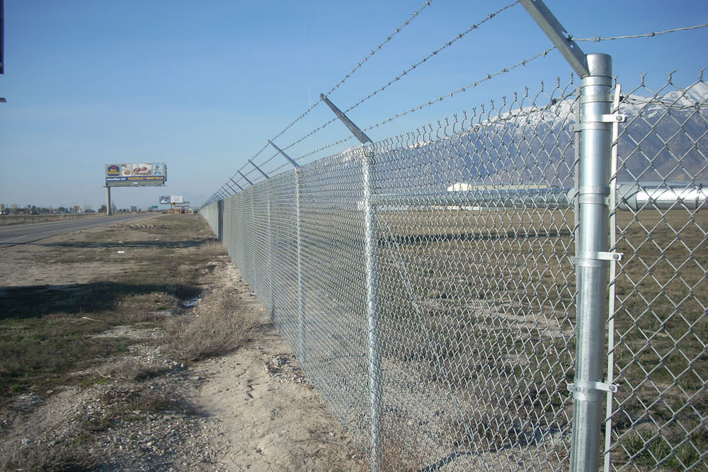 Custom Barbed Wire Fencing - WIRE Center •